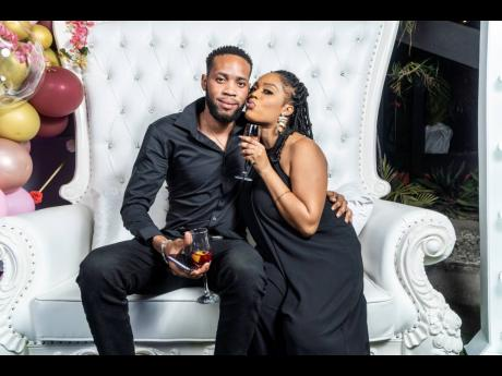 Shameer Burrell and Kara Jackson snuggle up for a cosy photo-op in the birthday chair.