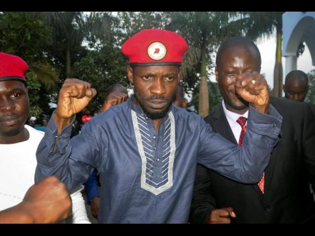 Ugandan pop star and opposition figure Bobi Wine greets his followers as he arrives home after being released from prison on bail in Kampala, Uganda, Thursday, May 2, 2019. Wine was freed on bail Thursday after spending three nights in a maximum-security p