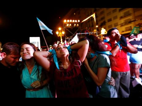 Anti-abortion activists react after lawmakers passed a bill that legalises abortion, outside Congress in Buenos Aires, Argentina, December 30, 2020.