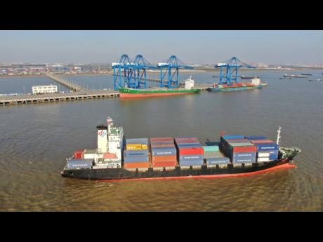 AP  A container ship leaves a port in Nantong, in eastern China's Jiangsu Province, on December 20, 2020.