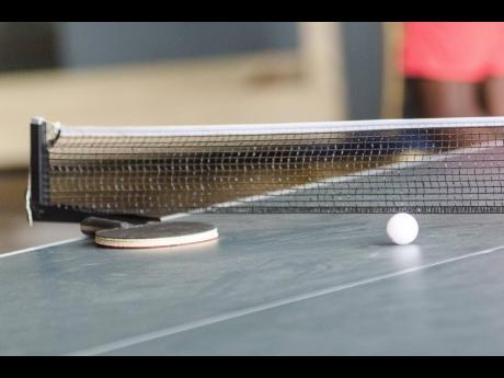 Table tennis racket and ball.