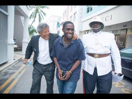 In this 2015 photo, Matthew Sewell (centre) and his lawyer Fred Smith QC (left) are heading to the Bahamian Supreme Court in Nassau. Sewell is escorted by a Bahamian policeman.