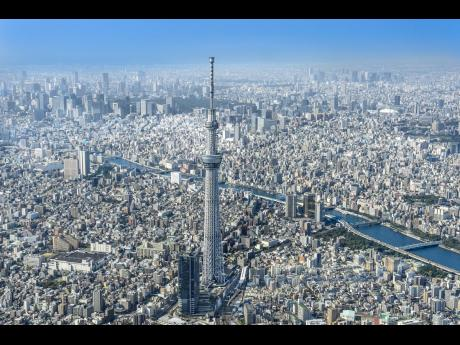 A panoramic view of the metropolis of Tokyo with the Tokyo Skytree standing tall over the city