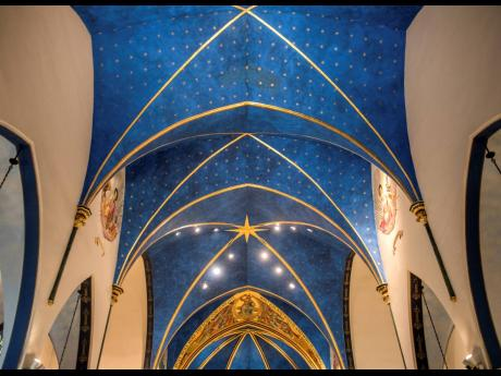 Nearly 5,000 stars are painted on the blue ceiling of the sanctuary at St. Mark's Catholic Church in Peoria, Ill. Peoria artist Andrew Hattermann and the artists of Murals by Jericho have built a successful business painting and beautifying churches all