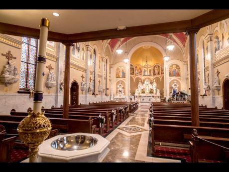 Murals adorn Sacred Heart Catholic Church in Peoria, Ill.