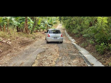 A section of the road in Marlie, St Mary, which is in urgent need of repair. Member of parliament Robert Montague has assured the rersidents that he is addressing the problem and also promised to provide pipe water to the communitiy.
