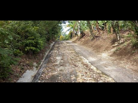 A section of the road in Marlie, St Mary, which is in urgent need of repair.