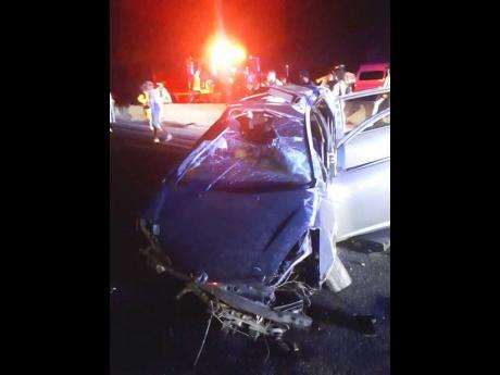A photo of the wrecked Toyota Wish motor car in which three persons perished on the Portmore toll highway on Sunday.