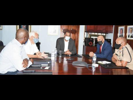 Listening intently: Commissioner of Police Major General Antony Anderson (second right) and his team met with representatives of the Shipping Association of Jamaica (SAJ) on Thursday, January 14, to discuss security and traffic arrangements at the port com