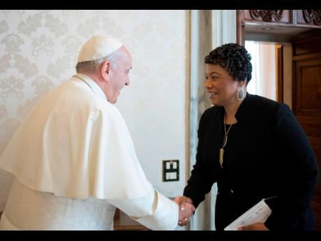 In this March 12, 2018 file photo, youngest child of civil rights leader Martin Luther King Jr, Bernice King, is welcomed by Pope Francis on the occasion of their private audience at the Vatican.