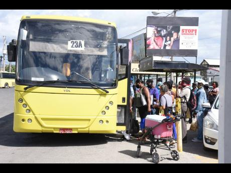 Passengers board a Jamaica Urban Transit Company bus in Spanish Town, St Catherine.