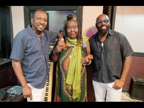 Good Samaritan entertainers Little Lenny (left) and Richie Stephens flank rediscovered songbird Yvonne Sterling.