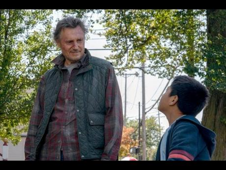 Liam Neeson stars as a rancher who risks his life to help a young migrant boy in 'The Marksman'.