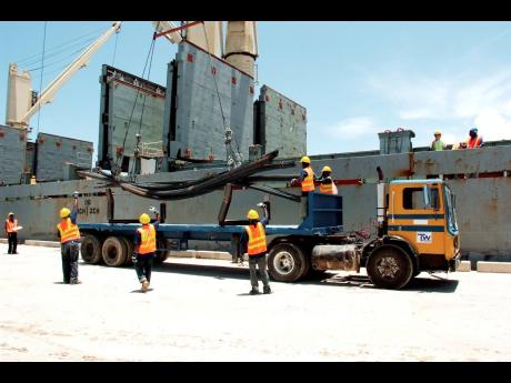 This Gleaner file photo shows steel being offloaded at the Tank-Weld port in Rio Bueno, Trelawny.