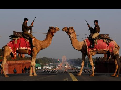 Camel mounted Border Security force soldiers make a formation during the rehearsals for the upcoming beating retreat ceremony which marks the end of Republic Day celebrations at the Raisina hills, the government seat of power, in New Delhi, India, Thursda