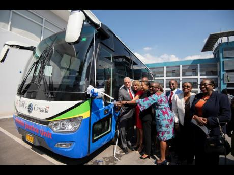 The ribbon cutting ceremony for the handover of two mobile justice unit buses at the Ministry of Justice in January 2020. The vehicles were funded by the Canadian Government in partnership with the United Nations Development Programme.