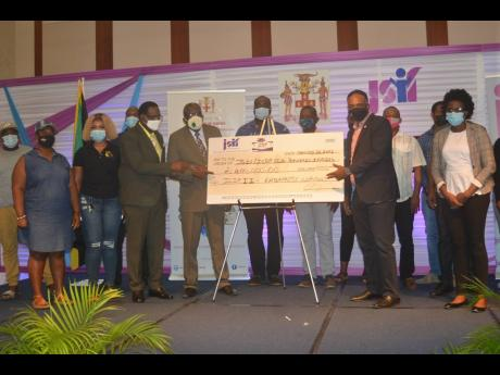Montego Bay Mayor Leeroy Williams (third from left); Reverend Conrad Pitkin (fourth from left), Custos of St James; and Omar Sweeney (second from right), managing director of the Jamaica Social Investment Fund, in a group shot with several business operato