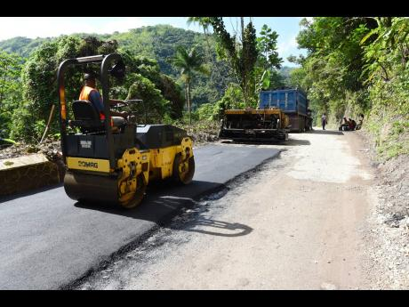 Crewmen pave the road between Broadgate and Devon Pen along the Junction corridor in St Mary last Friday.