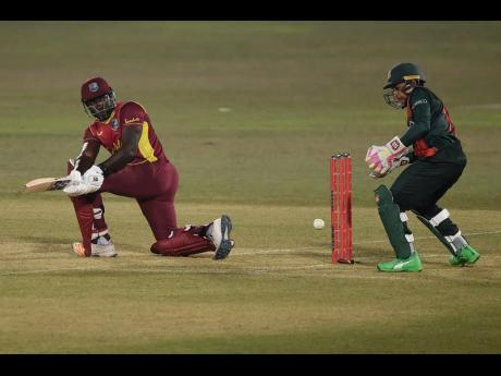 West Indies batsman Rovman Powell (left) plays a sweep shot during his innings of 47 against hosts Bangladesh in their third One-Day International in Chattogram, yesterday.