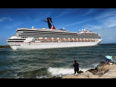 In this March 9, 2020 photo, the Carnival Liberty leaves Port Canaveral, Florida.