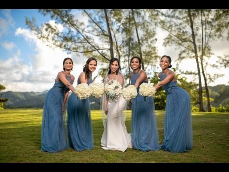 Melissa Robinson (centre) is joined on her special day by her supportive bridesmaids. From left: Trusha Goffe, Shari Dacosta, Rachel Robinson and Alicia Robinson.