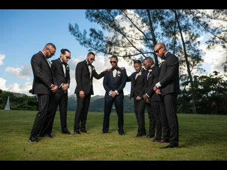 Friends that pray together stay together. Groom Ricardo Gordon (centre) is surrounded by his groomsmen (from left), Richard Gordon, Robin McFarlane, Matthew Waddell, Duane Gordon, Jeremy Thompson and Ainsley Deer.