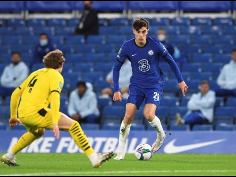 Barnsley's Callum Styles tries to stop Chelsea's Kai Havertz (right) during the English League Cup third round match between Chelsea and Barnsley at Stamford Bridge in London, Wednesday, September 23, 2020.