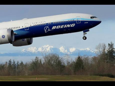 In this January 25, 2020 file photo, a Boeing 777X airplane takes off on its first flight.
