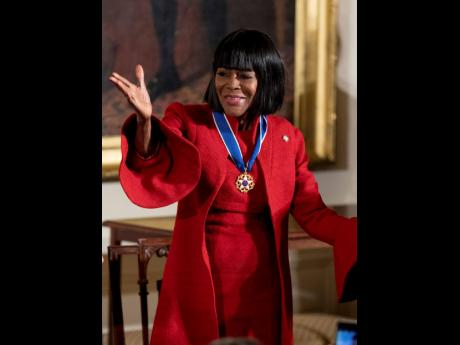 Actress Cicely Tyson blows a kiss after receiving the Presidential Medal of Freedom from President Barack Obama during a ceremony in the East Room of the White House, November 22, 2016, in Washington. Tyson, the pioneering Black actress who gained an Oscar
