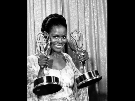 Cicely Tyson poses with her Emmy statuettes at the annual Emmy Awards presentation in Los Angeles, California, May 28, 1974. Tyson won for her role in 'The Autobiography of Miss Jane Pittman' for Actress of the Year, Special, and Best Lead Actress in a
