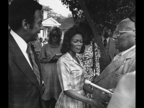 From left: Ambassador Andrew Young talks to actress Cicely Tyson and Reverend Martin Luther King, Sr on the set of 'Martin Luther King, Jr' while it was filmed in Macon in 1977.