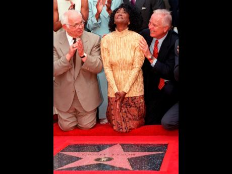 Academy Award-nominated actress Cicely Tyson (centre), reacts to the unveiling of her star on the Hollywood Walk of Fame in the Hollywood section of Los Angeles, August 21, 1997. Honorary mayor of Hollywood and chairman of the Walk of Fame committee, John