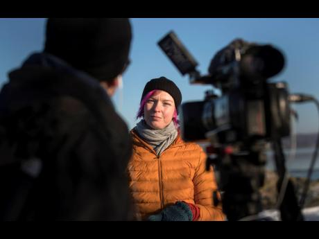 Lisa Enroth is interviewed on the island of Hamneskar, western Sweden on Saturday. The 44th Goteborg Film Festival opened this weekend in a mostly virtual format, but an emergency ward nurse from Sweden was selected among 12,000 volunteers to spend a week