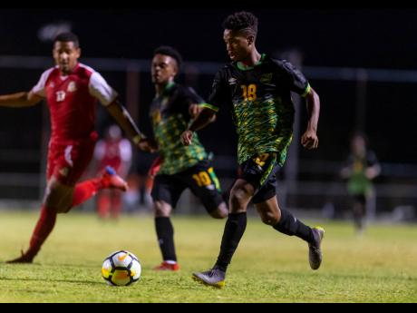 Jamaica's Lamar Walker (right) in action ahead of teammate Alex Marshall (centre) and opponent Ezrick Nicholls of St Kitts and Nevis in an Olympic qualifier, played at the Anthony Spaulding Sports Complex on Sunday, July 21, 2019.