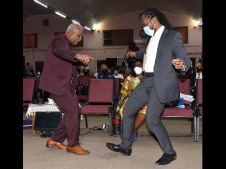 The Reverend Merrick 'Al' Miller (left), pastor of Fellowship Tabernacle, and Alando Terrelonge, state minister in the Ministry of Culture, Gender, Entertainment and Sport, shows off their dance moves during the Reggae Month church service held at Fellowsh