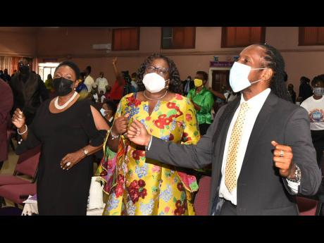 Minister of Culture, Gender, Entertainment and Sport Olivia 'Babsy' Grange (left), takes part in a church service for Reggae Month on Sunday at the Fellowship Tabernacle in Kingston. Also participating are: Alando Terrelonge, minister of state in the c