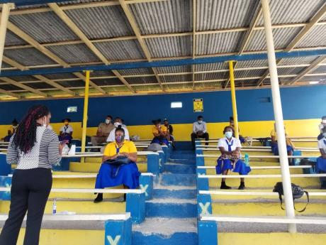 Maud McLeod  High School studentsengaged in classwork  in one of thepavilions at the school.