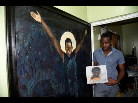 Constable Malcolm Lindsay, seen here with a few of his artworks, says that casting his emotions on canvas is therapeutic.