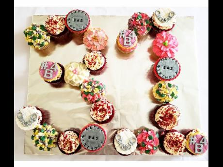 Twenty-four assorted cupcakes form the number 31 in this special birthday creation.