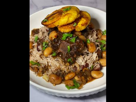 It doesn't get more Jamaican than rice and peas, oxtail and beans, and fried plantains.