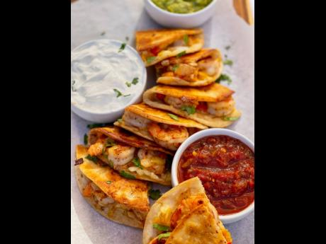 These shrimp quesadillas were served with three dips.