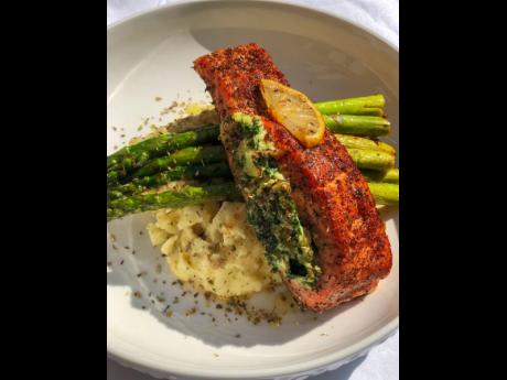 Pan-seared salmon, stuffed with spinach and mozzarella and cream cheese, on a bed of buttery asparagus and creamy garlic mashed potatoes.