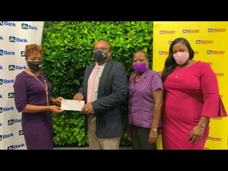 Carlene Stair (left), head of Customer Experience and Service Recovery, JN Bank, and Sanya Wallace (right), senior manager – Strategy and Marketing, JN Money Services, present Michael Leslie (centre), acting executive director, Jamaica Cancer Society (JC