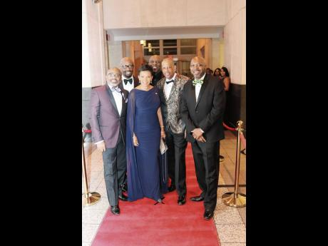 Jamaica's Ambassador to the United States Audrey Marks (centre) is flanked by committee members of the Washington, DC-based David 'Wagga' Hunt Scholarship Foundation, at the 2019 fundraising gala. From left: Lloyd Anderson, Michale McPherson, Garth P