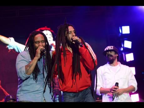 From left: Marley brothers Ky-Mani, Julian, and Damian pay tribute to their father, Bob Marley, during the commemoration of the late reggae icon's 70th birthday anniversary. The concert was dubbed 'Redemption Live'.