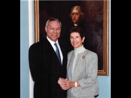 Secretary of State Colin Powell with Ambassador Sue Cobb at a diplomatic event at the State Department (2001-2005).