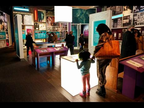 Visitors look at information presented at the National Museum of African American Music.