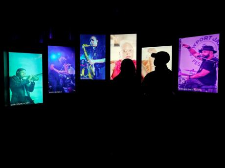 Visitors watch an exhibit at the National Museum of African American Music.