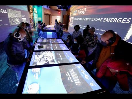 People look at an interactive exhibit in the National Museum of African American Music.