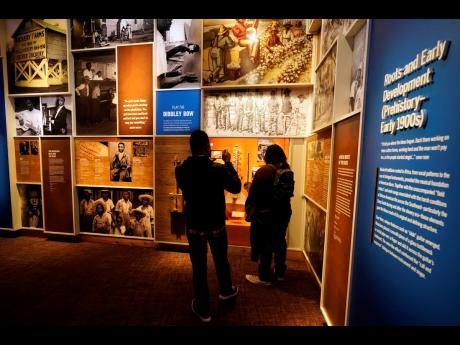People look at an exhibit in the National Museum of African American Music.